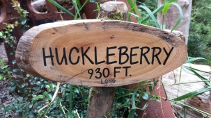 Huckleberry Zip Line Sign